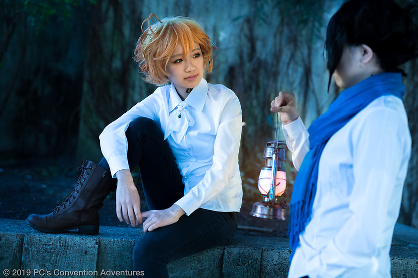 __milkeu cosplaying as Emma and sapphireknights as Ray from The Promised Neverland at SakuraCon